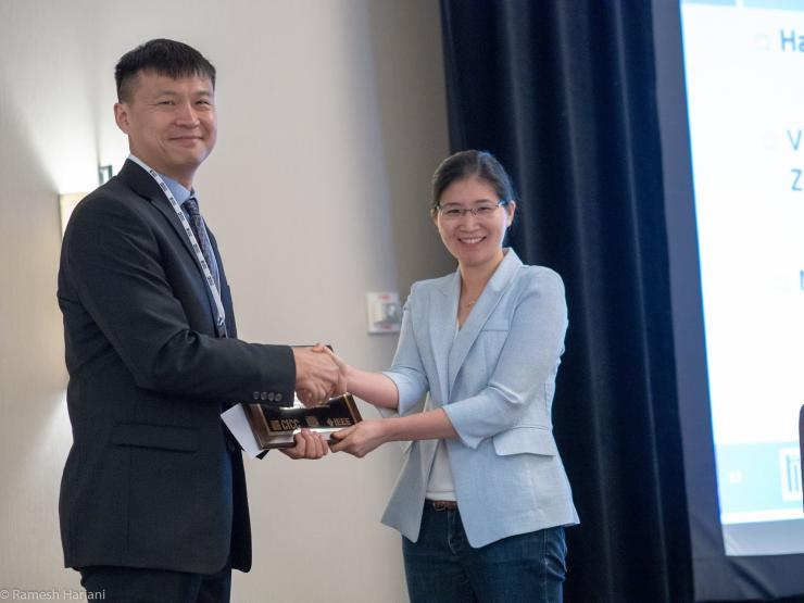 Vivienne Sze receives award from Kimo Tan, General Chair of CICC 2018 and MIT EECS and MTL alumnus.